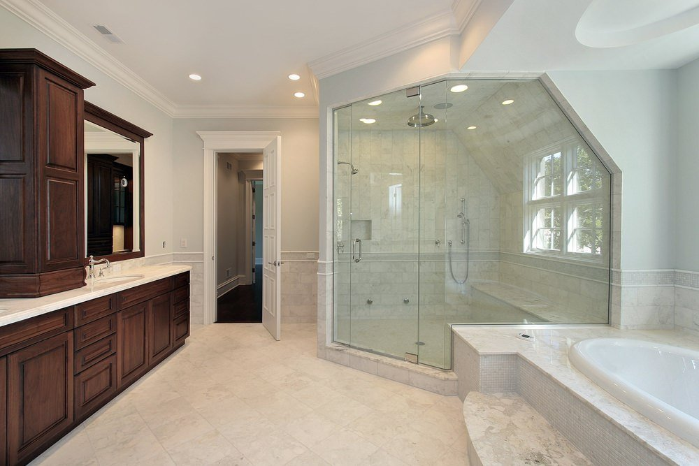Master bathroom with white walls and a white ceiling. It also features a drop-in tub and a walk-in shower room.