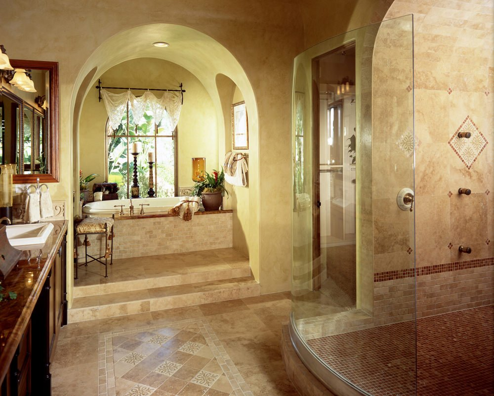 Primary bathroom with a large walk-in shower and a drop-in tub under the cathedral ceiling. The sink counter looks absolutely magnificent.