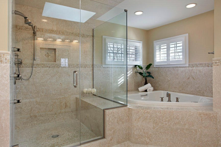 The clever creators behind this bathroom design managed to make both the corner bathtub and shower look like one seamless creation. Perfect for maximizing space in cramped rooms.