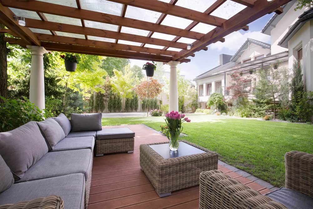 This deck offers cozy seats and a gorgeous view of the home's garden area.