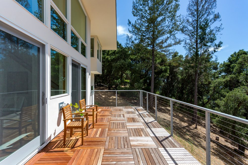 This deck offers a great view of the surrounding trees. The seats matches the flooring for a perfect look.