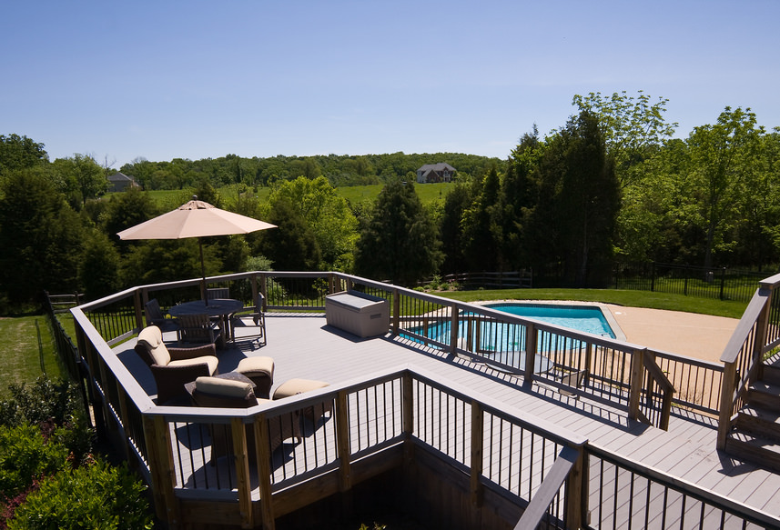 This deck offers a couple of comfortable chairs with footrests and a shaded small dining table set. Also it overlooks the stylish pool and the beautiful nature surrounding the area.