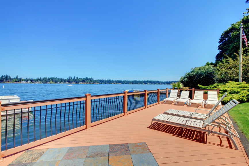 This deck offers a set of lounger seats overlooking the beautiful wide river mirroring the blue skies.