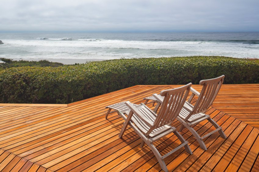 This deck features a lounger seats in front of the beautiful greenery. The ocean can be overlooked from the deck area.