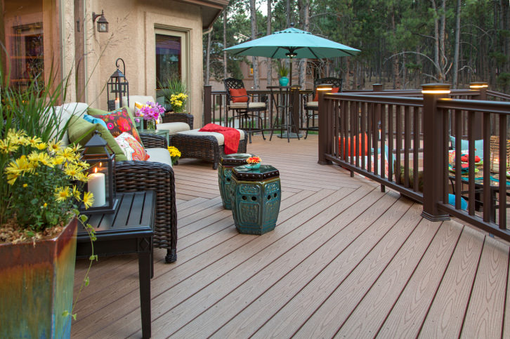This deck features comfortable seats and classy side tables with candle lights. Beautiful plants add elegance to the lovely place.