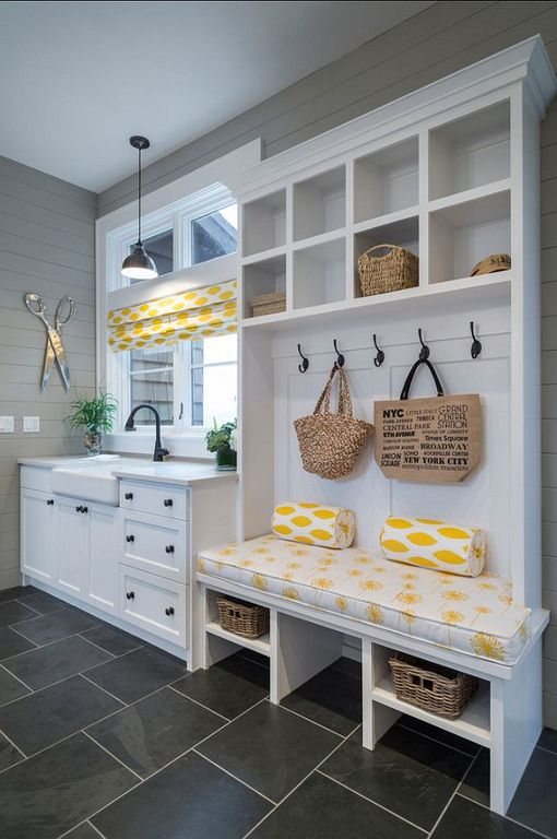 Cute white and yellow mudroom with dark gray tiles. Source: Zillow ...