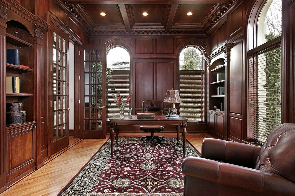 A Victorian type of library with hardwood flooring. The dominant material used is wood, giving it the reddish-brown finish.