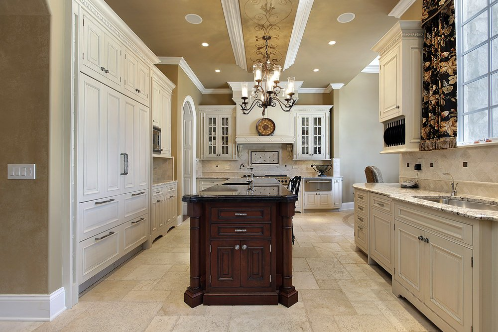 A kitchen featuring tiles floors and a stunning ceiling lighted by a glamorous chandelier.