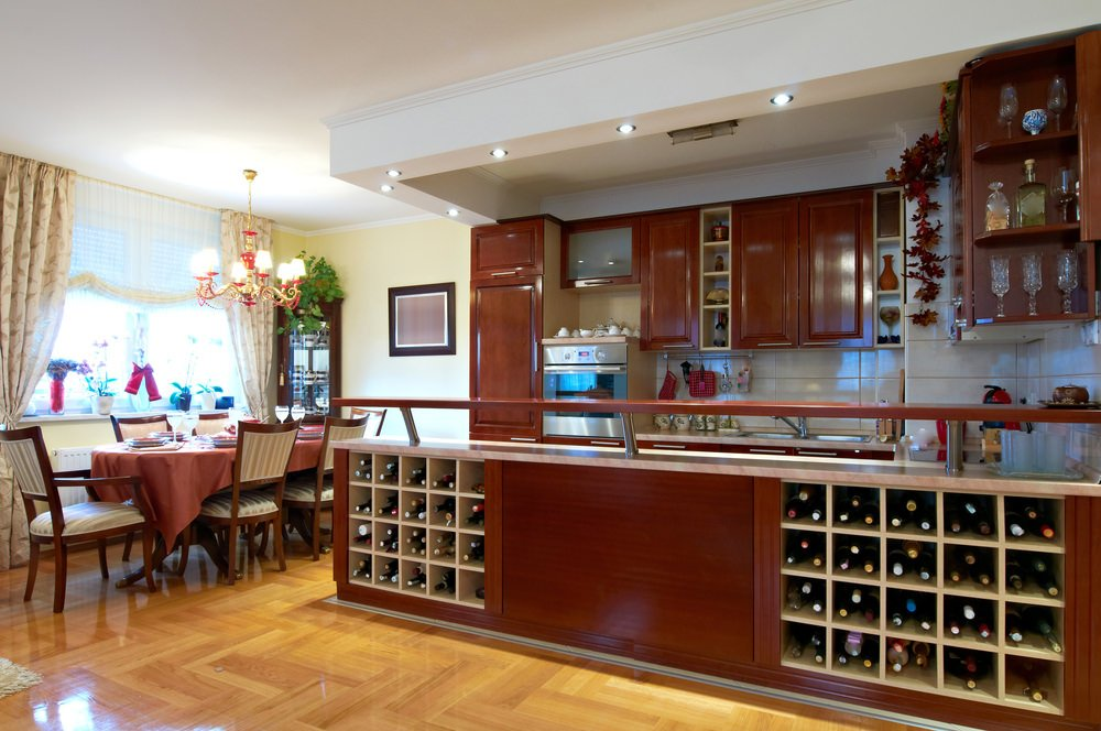 This beautiful kitchen features lovely kitchen cabinetry and counters, along with a couple of wine cellar. The main kitchen area also features a tray ceiling.