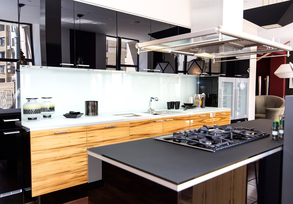 This kitchen offers a very stylish countertop on the center island with a stove. The kitchen counters look so lovely together with the white countertop.