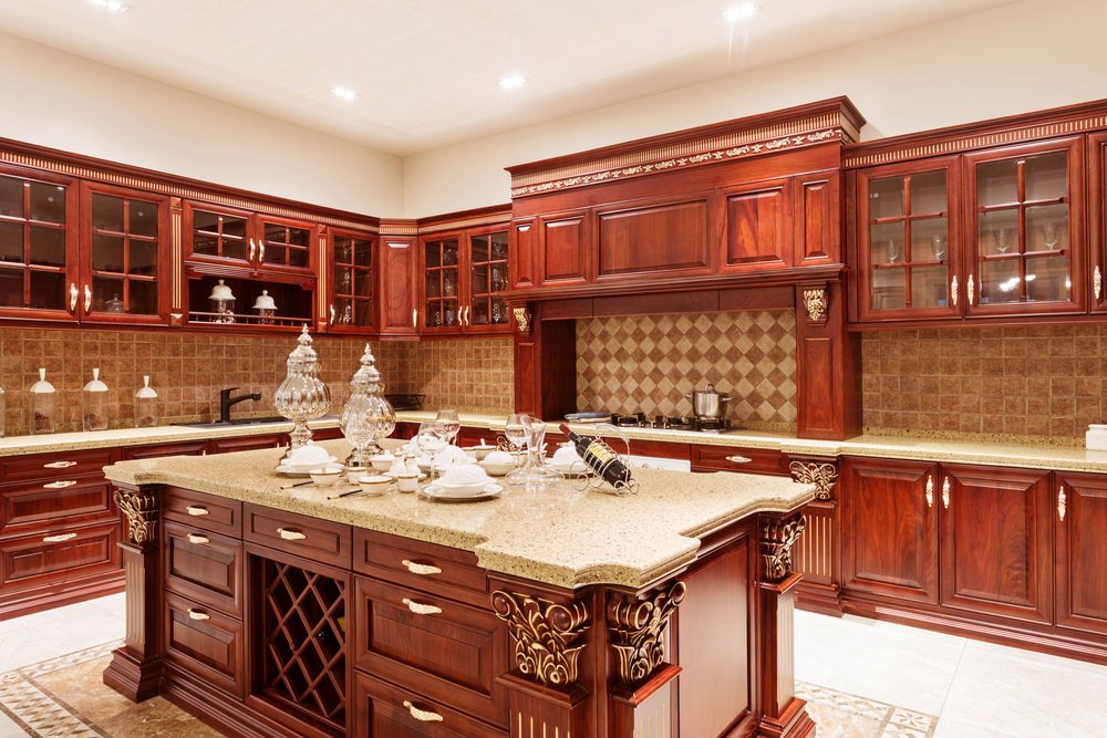 Rustic Mediterranean kitchen with beautiful cabinetry and center island color. The counters matches well with the large center island perfect for preparing big meals.