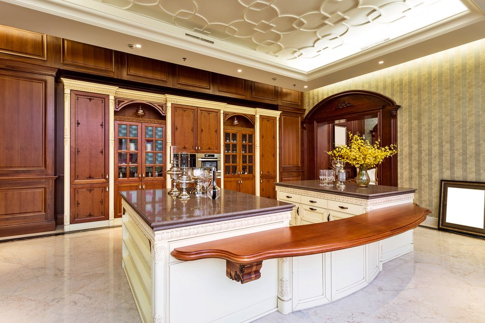 Large kitchen with lovely counters and bar, together with the beautiful cabinetry. The walls and floors are so gorgeous, together with the tiles flooring.