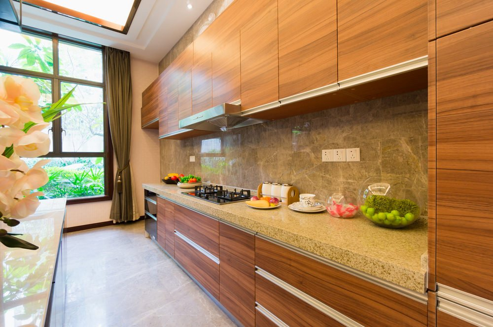 This single wall kitchen features beautiful cabinetry and kitchen counters that features lovely countertop.