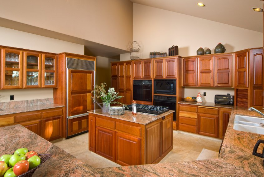 The cherry-finished cabinetry and kitchen counters make this kitchen look gorgeous. The countertops add class to the area.