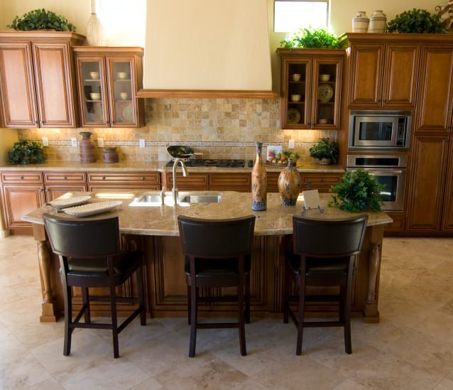 This single wall kitchen features a small center island with a classy countertop. It also provides a small space for a breakfast bar.