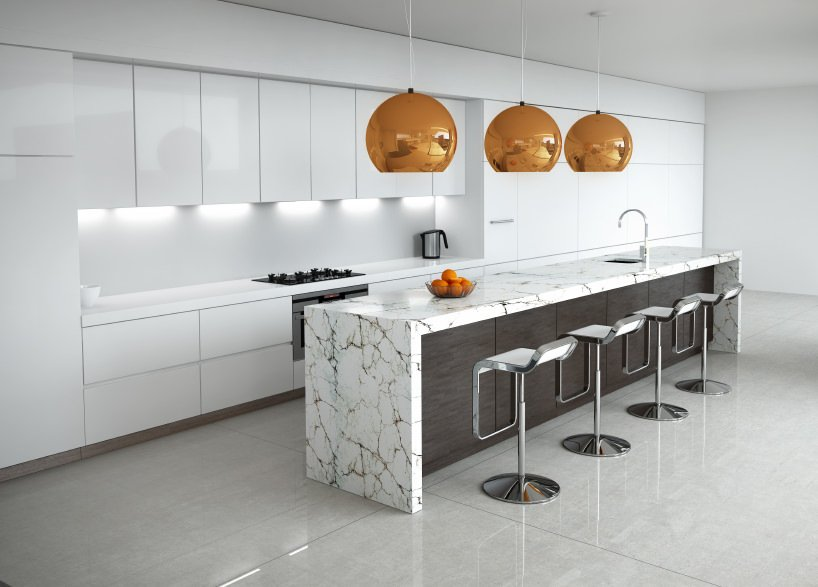 The contemporary kitchen offers sleek white cabinetry and a wooden island bar topped with marble counter and lighted by huge bronze pendants.