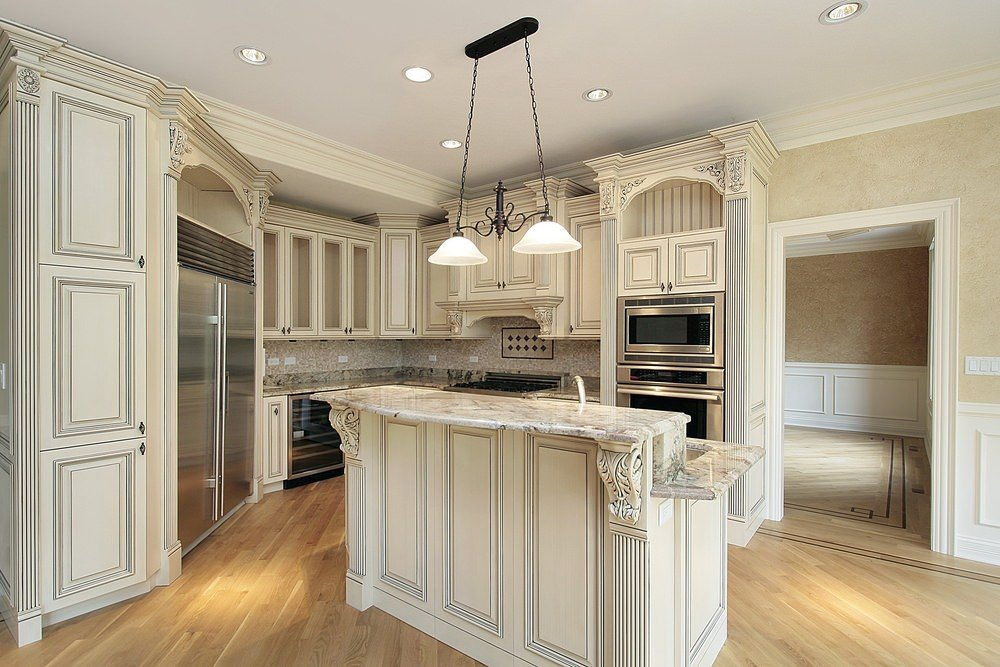 This kitchen offers a classy counter with marble countertop and is lighted by a fabulous pendant lighting.