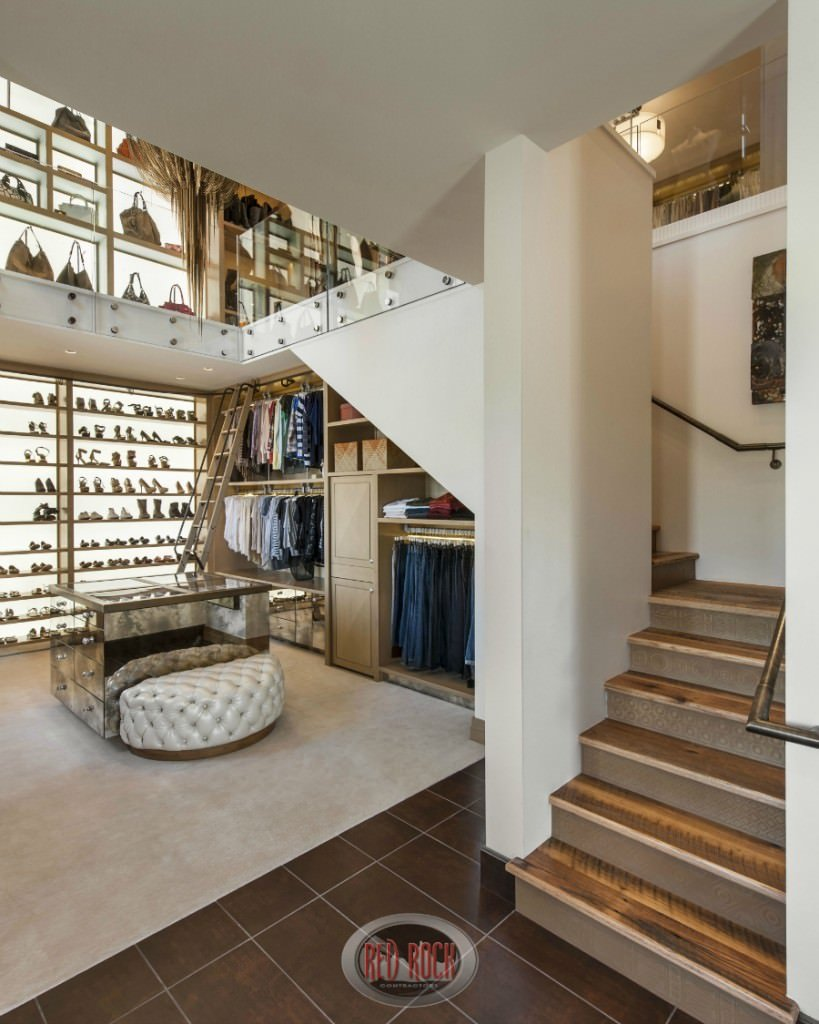 Taken from a different angle, this picture shows the stairs leading up to the second floor, and a portion of the closet fit in underneath the stairs.