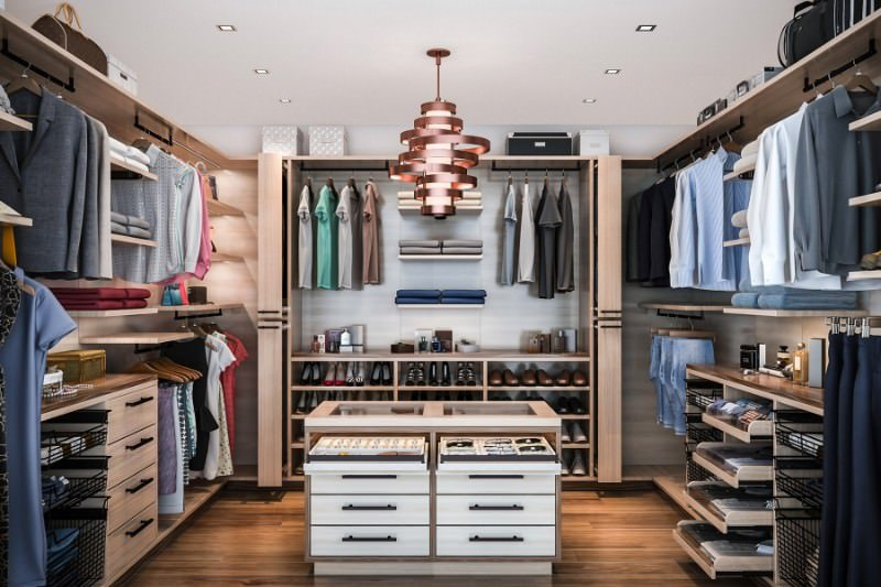 This modern women's closet offers an elegant center island and a pendant lighting. The cabinets are also gorgeous.