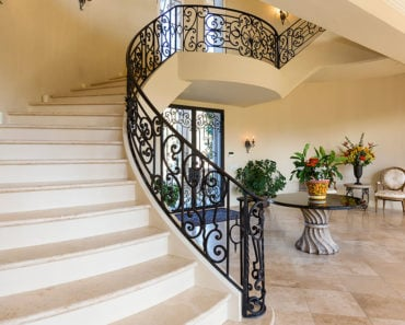 Britney Spears' front foyer in mansion entrance with winding staircase.