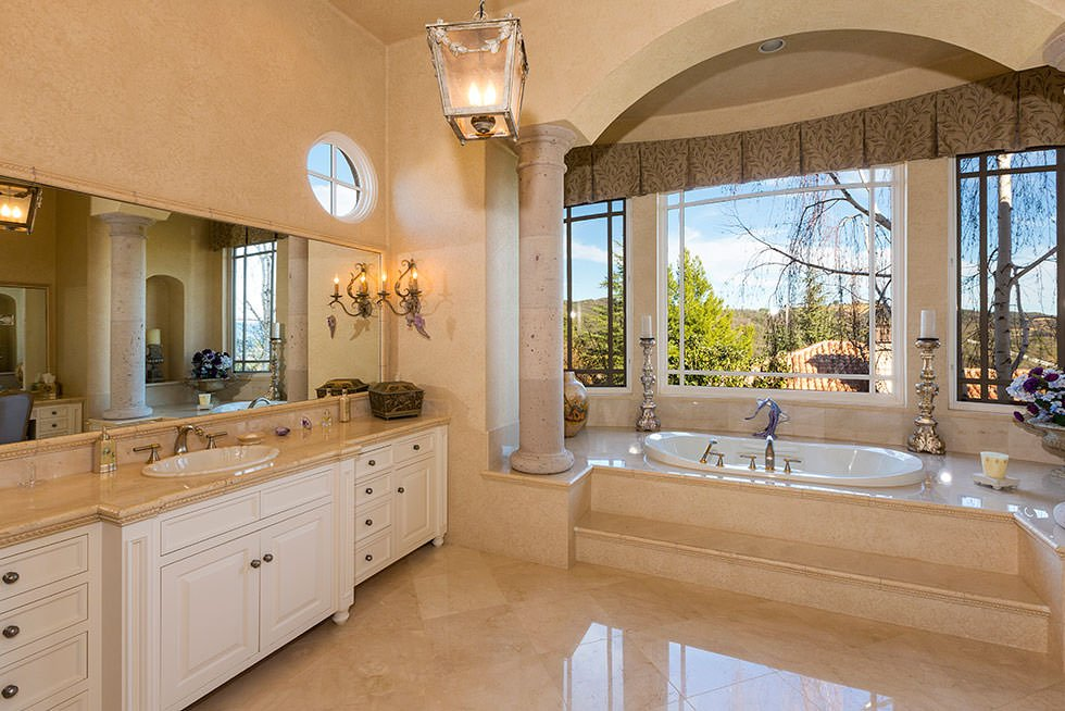 Britney Spears' master bathroom with picture window bathtub alcove.