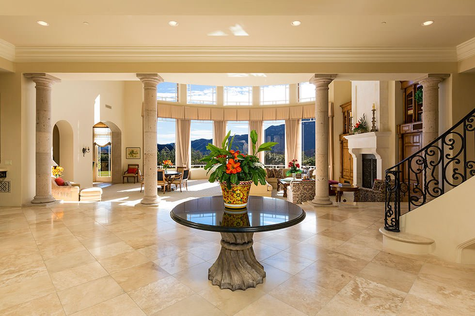 Massive foyer in Britney Spears house with decorative table.