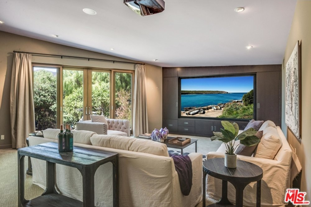 Media room with huge TV screen in Chris Hemsworth's and Elsa Pataky's house.