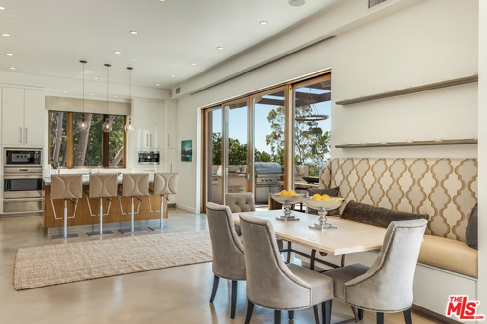 Dining room with built-in bench in Chris Hemsworth's and Elsa Pataky's Malibu home.