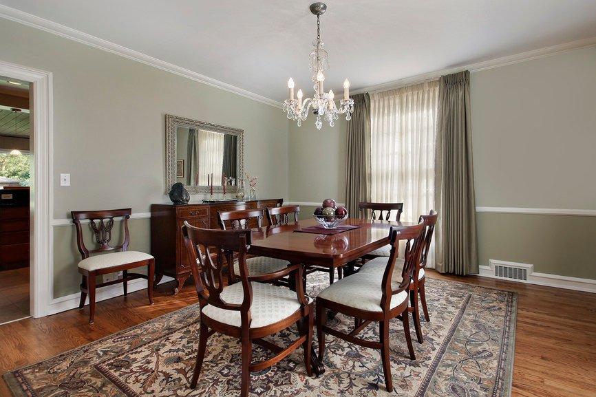 Dining room in luxury home with buffet table.