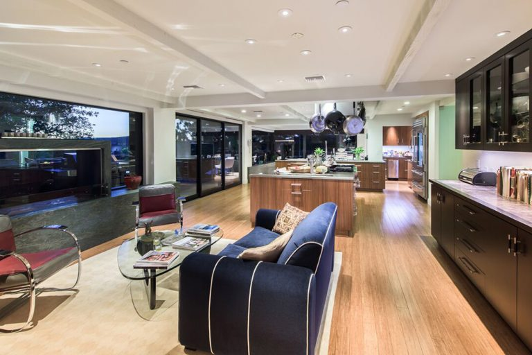 Open concept kitchen and family room in beautiful home once owned by Jane Fonda
