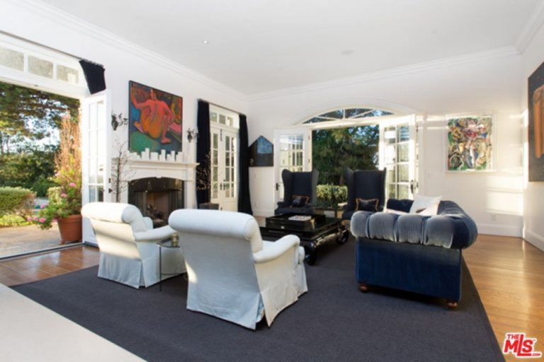 Photo of Jessica Alba's family room with French doors to backyard.