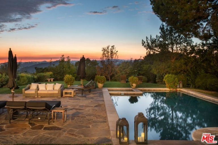 Photo of Jessica Alba's backyard patio and pool and view.