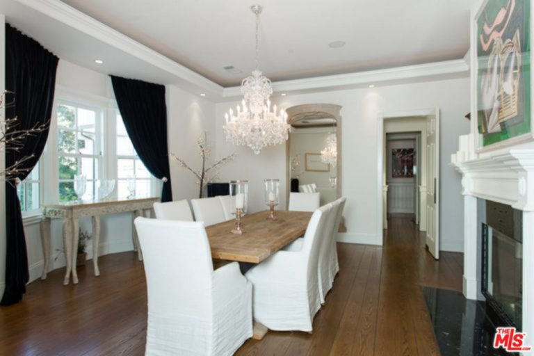 Jessica Alba's formal dining room with chandelier and table that seats 8 people.