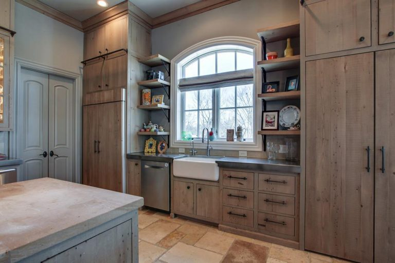 Kelly Clarkson's rustic contemporary kitchen design with farmhouse sink and massive floor to ceiling custom cabinetry