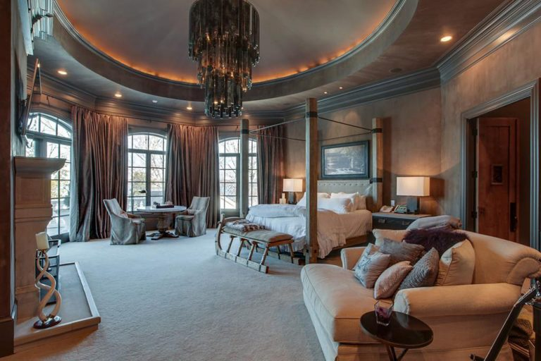 Kelly Clarkson's massive primary bedroom with sitting areas and tray ceiling.
