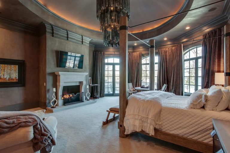 Kelly Clarkson's primary bedroom with fireplace.
