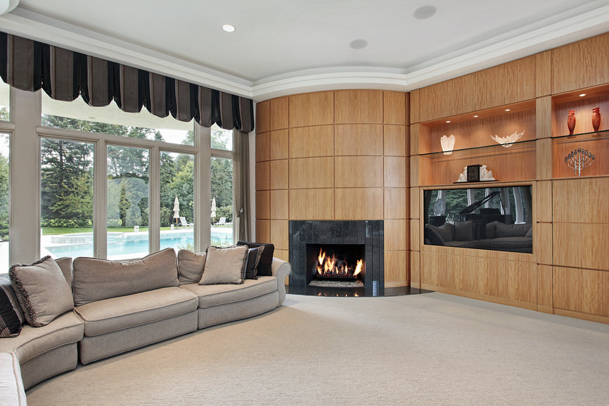 Living room with rounded fireplace