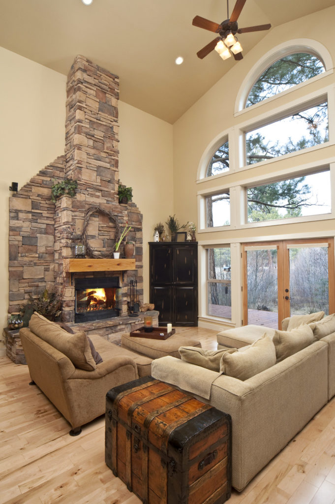 This living room offers a comfortable set of seats along with a fireplace keeping the area warm.