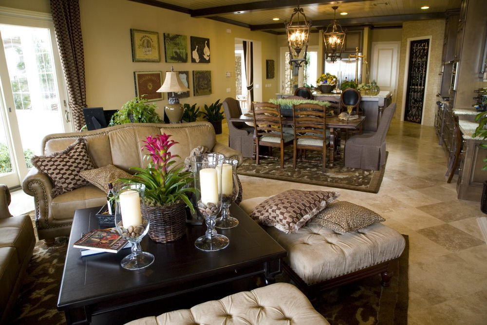 This great room offers an elegant living room set and a dining table set. The kitchen looks lovely as well.