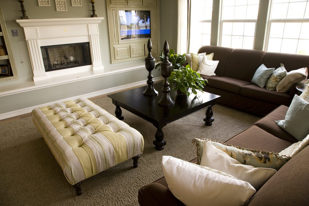 A modish living room set featuring a brown rug that looks perfect together with the brown sofa set. The gray walls look just perfect with the room's style.