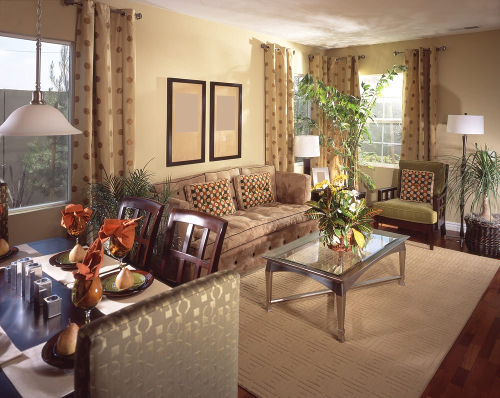Small living room with comfy seats and a stylish rug on top of the hardwood flooring.