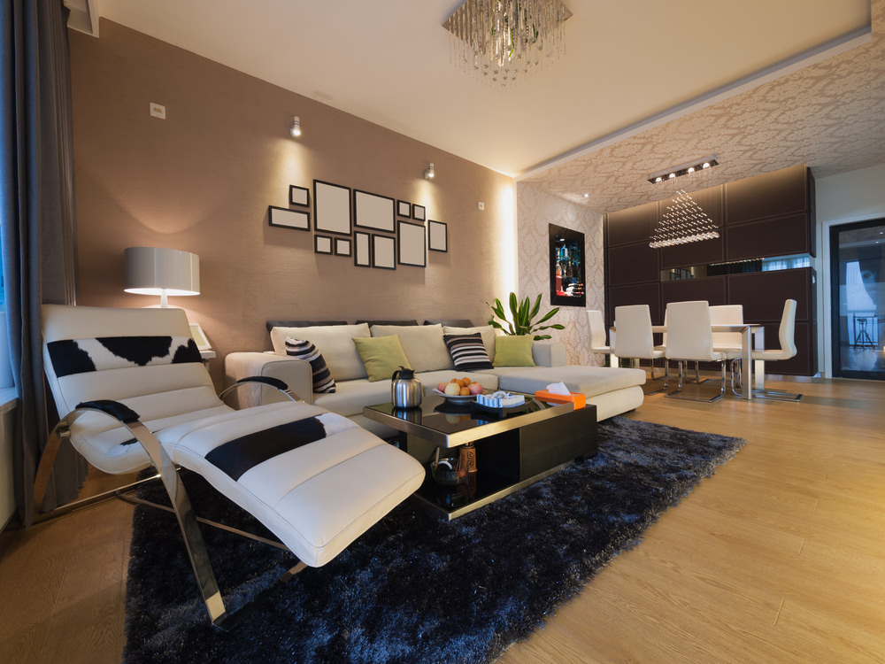 This great room features luxurious living room set, along with a lovely dining table set.