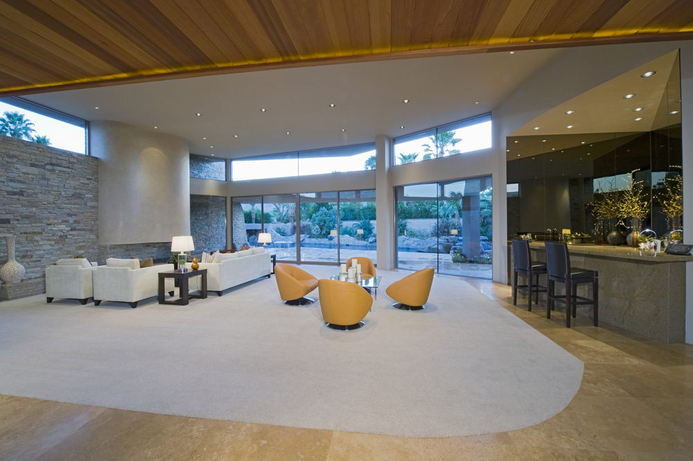 Large great room with an elegant kitchen with a bar, along with a charming dining nook and a cozy living space lighted by stunning recessed lights.