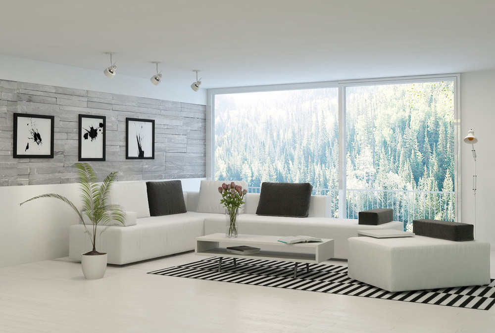 Spacious Scandinavian-Style formal living room featuring a white sofa set and an area rug, along with stylish wall decors and track ceiling lights.