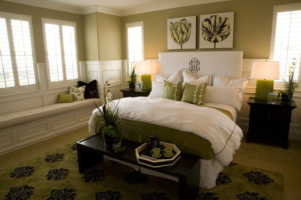 The built-in window beach is the star here, but so too is the white wall paneling and contemporary dark bedroom furniture.