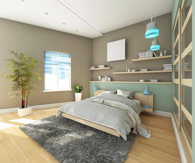 Primary bedroom featuring gray walls along with built-in shelves and stylish pendant lights. The room also has indoor plants adding color to the area.