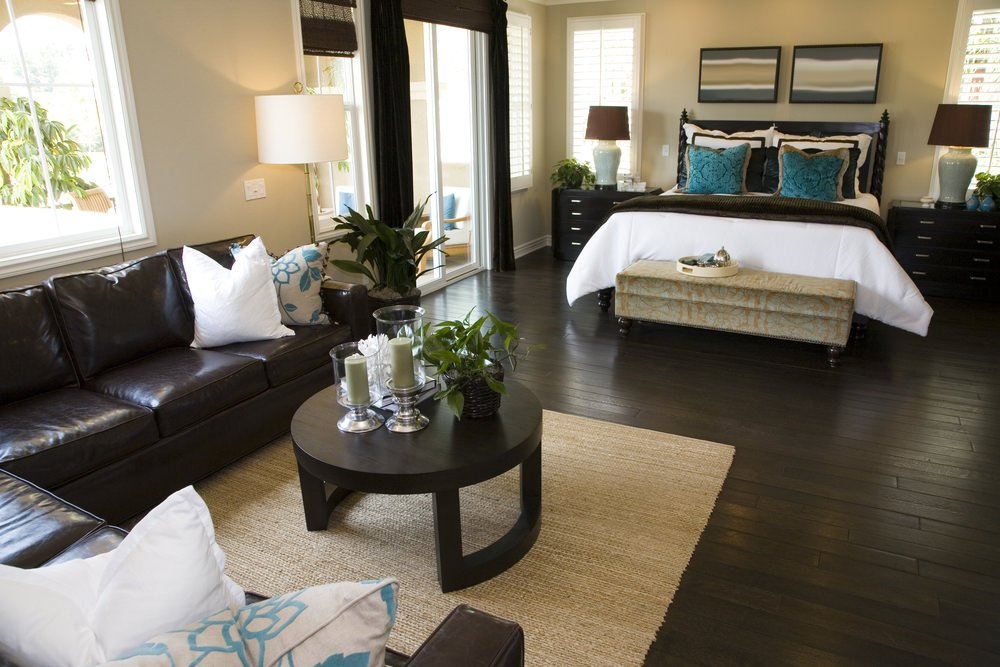 This bedroom offers a espresso hardwood flooring matching the room's furniture set.