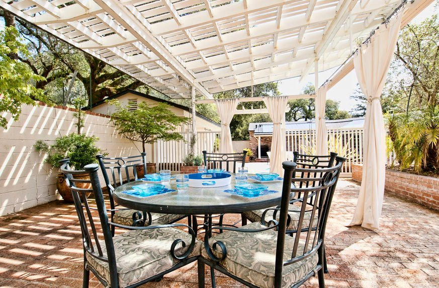 Large patio area featuring a round dining table set.