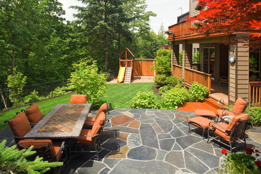 Beautiful garden area featuring a small patio with matching seats together with the dining table set.