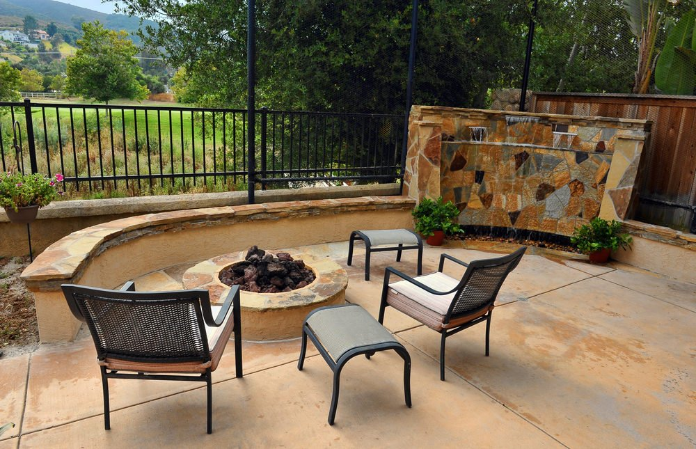 This patio offers a nice set of seats in front of a fire pit.